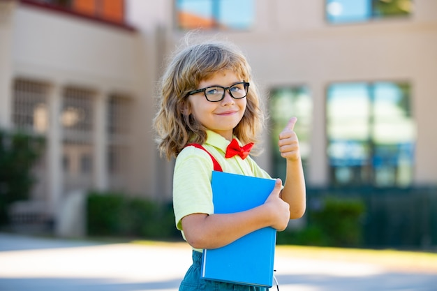 Little child school boy in first grade. pupil back to school.
