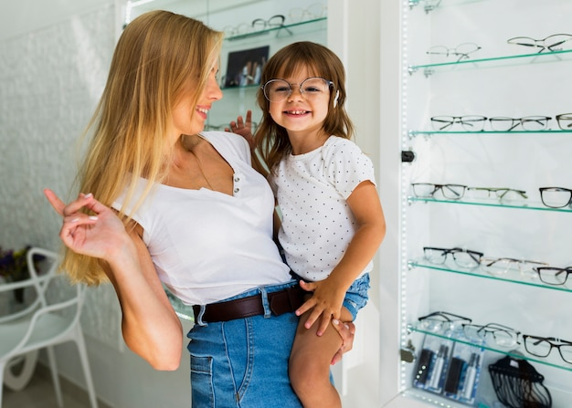 Little child trying on glasses frame