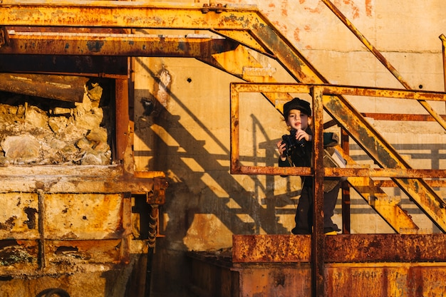 Little child with binoculars at steps