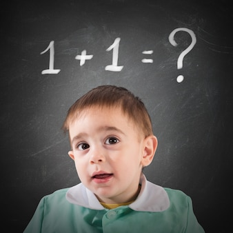 Little child with blackboard with math calculation