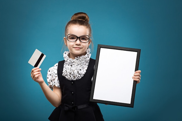 Little child with credit card dressed like teacher