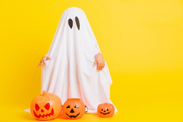 Little child with white dressed costume halloween ghost