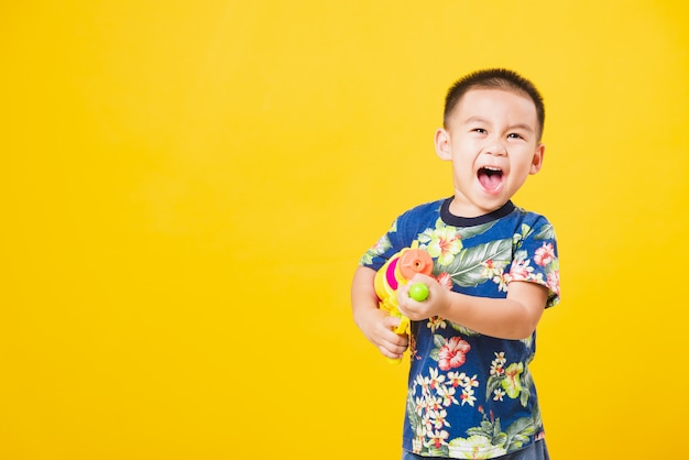 Little children boy in songkran festival day holding water gun