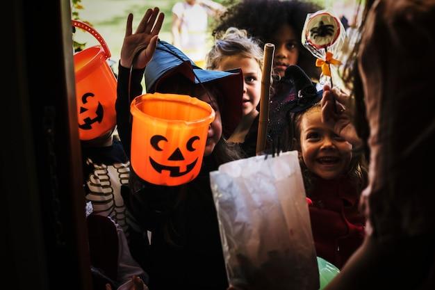 Little children trick or treating on halloween