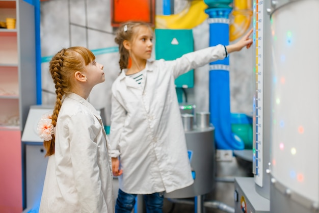 Little children in uniform playing doctors in laboratory