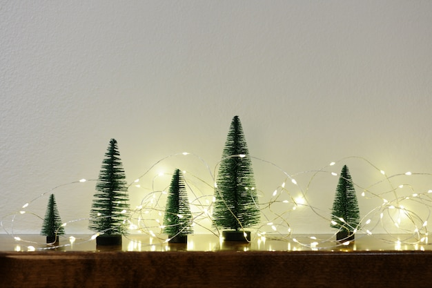 Little christmas trees with garland of lights