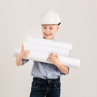 Little construction worker showing thumbs up