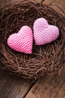 Little cozy nest with two crochet hearts. valentine's day decorations