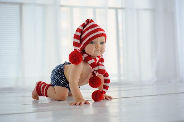 Little cute baby crawls on the floor.