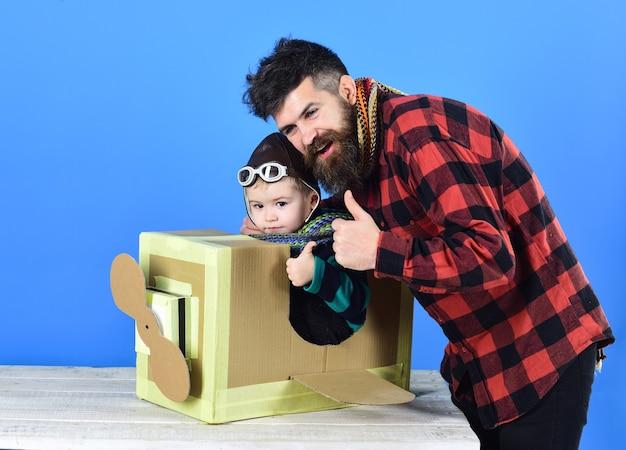 Little cute boy. cute boy playing with cardboard airplane. retro style cardboard