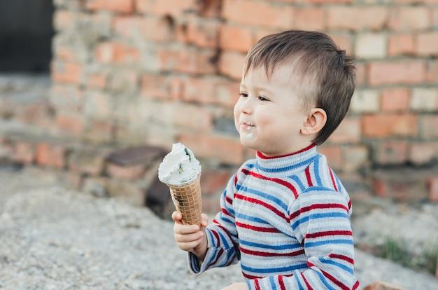 Little cute boy eating ice cream