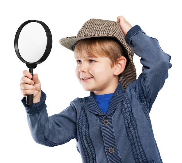 Little cute boy with magnifying glass isolated on white background
