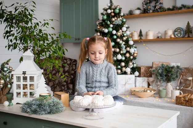 Little cute child in kitchen at christmas home.