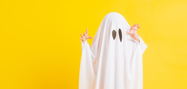 Little cute child with white dressed costume halloween ghost scary