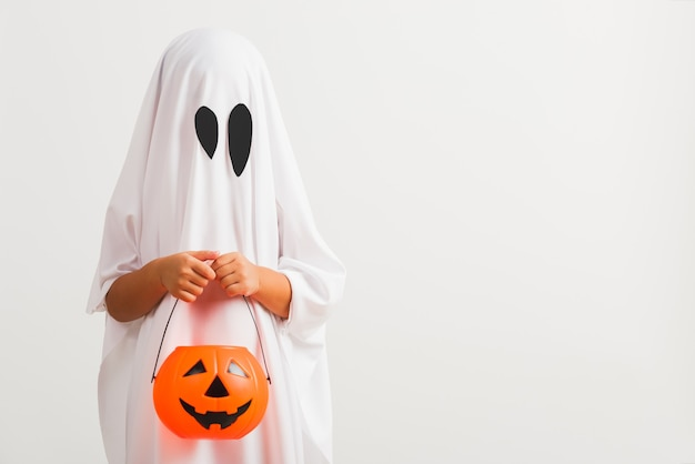 Little cute child with white dressed costume halloween ghost