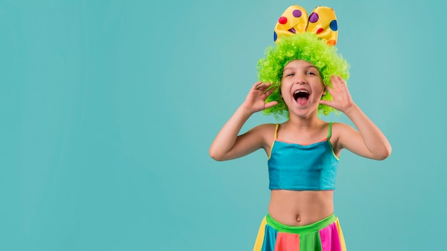 Little cute girl in clown costume with copy space