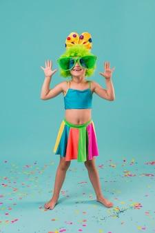Little cute girl in clown costume