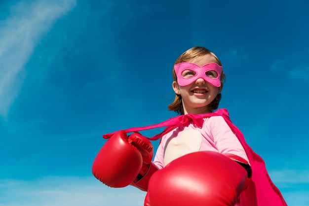 Little cute girl playing superhero  we are proud to support hope