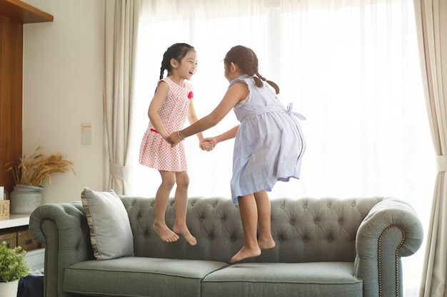 Little cute girls playing at her home