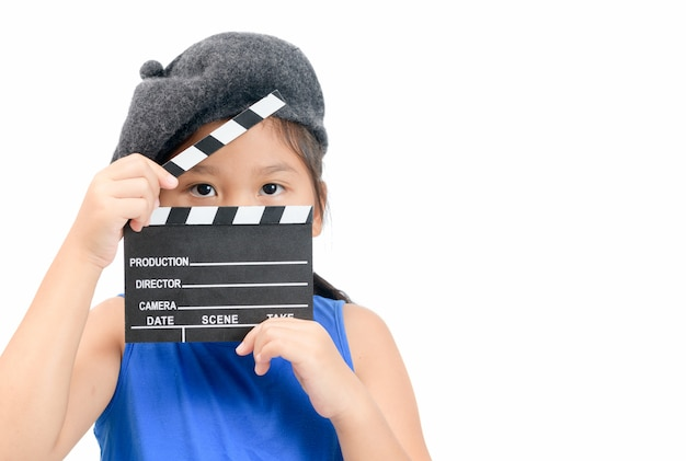 Little director holding clapper board or slate film