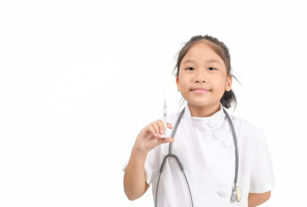 Little doctor holding a syringe isolated