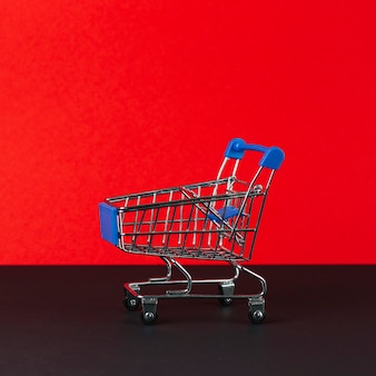 Little empty shopping trolley