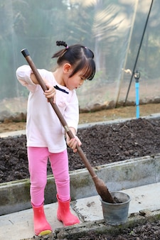 Little farmer girl in gardening
