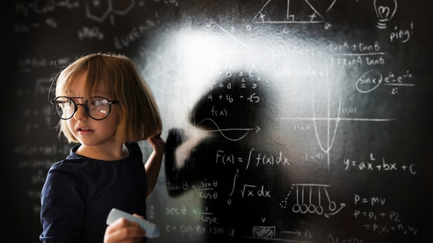 Little genius solving algebra in class