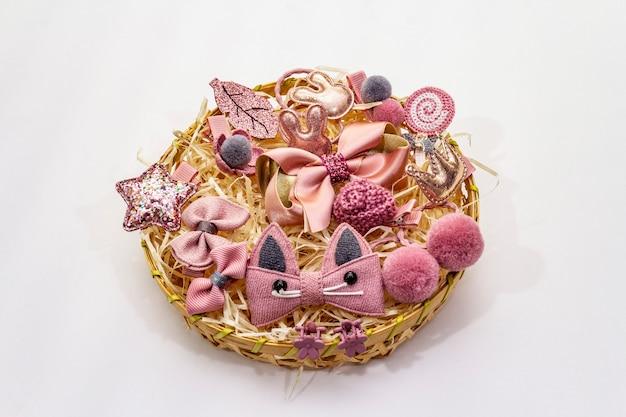 Little girl accessories in a wicker basket