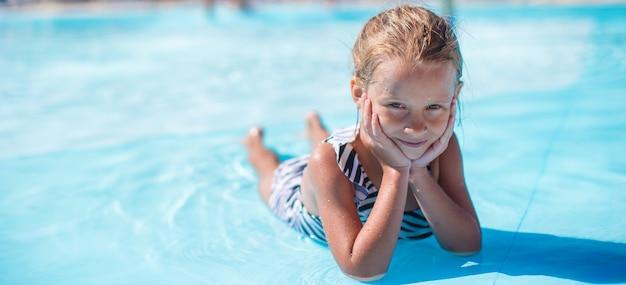 Little girl at aquapark during summer vacation