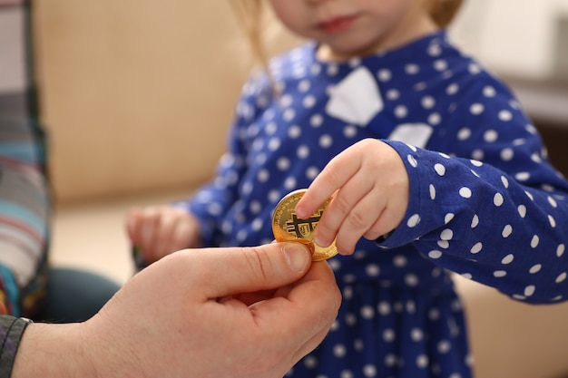 Little girl arm collecting crypto coins