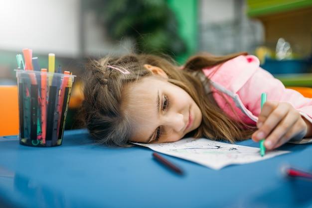 Little girl asleep on playground