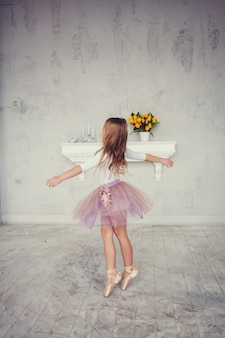 Little girl in beautiful dress is dancing