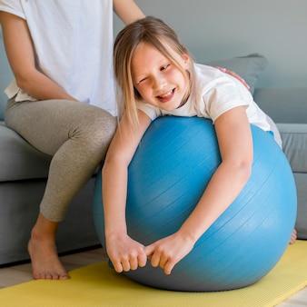 Little girl on bouncing ball