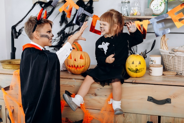 Little  girl and  boy are  scary each otherhalloween