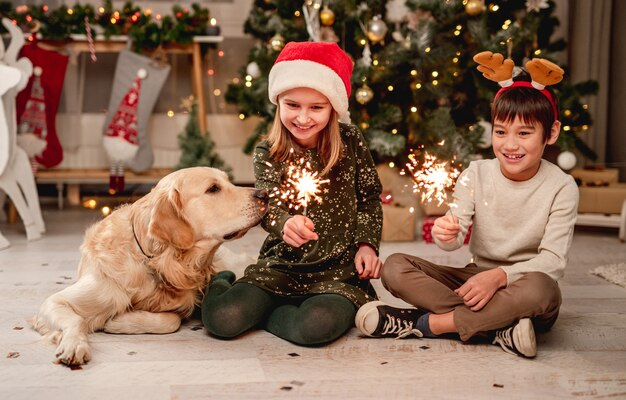 Little girl and boy holding sparklers