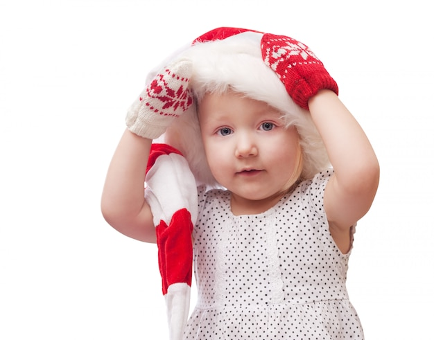Little girl in a cap of santa claus
