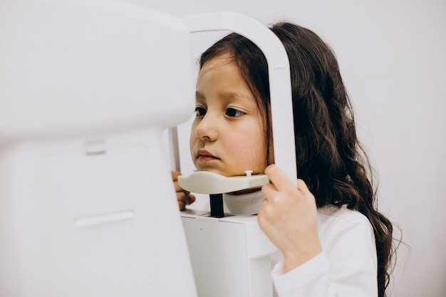 Little girl checking up her sight at ophthalmology center