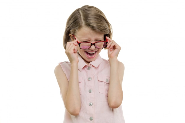 Little girl child in glasses screaming, crying