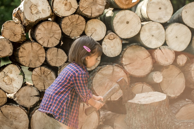 Little girl chopping wood