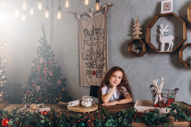 Little girl in christmas lights and decorations