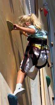 Little girl in a climbing wall