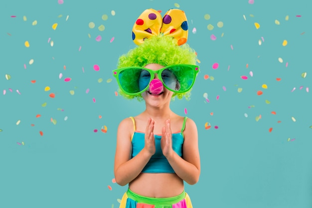 Little girl in clown costume
