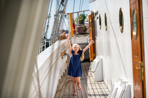 A little girl on the deck of a large sailboat in the city of klaipeda.lithuania