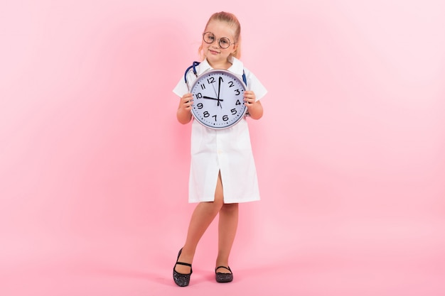 Little girl in doctor costume with clocks