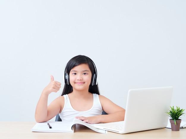 Little girl doing online class