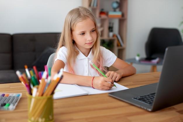 Little girl doing online classes Premium Photo