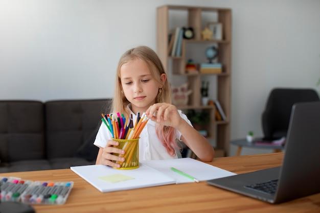 Little girl doing online classes