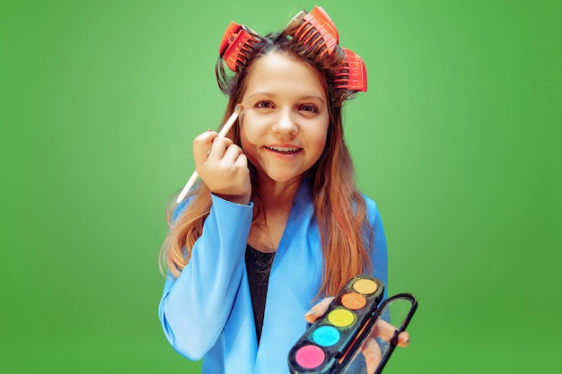 Little girl dreaming about profession of makeup artist. childhood, planning, education and dream concept.