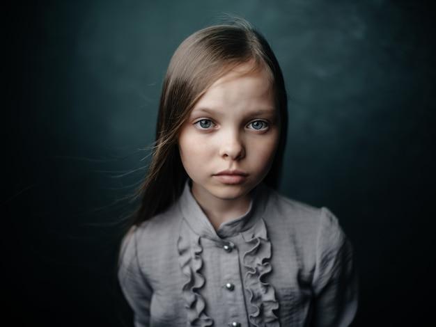 Little girl in dress posing studio isolated background